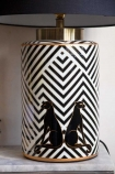 Close-up image of the lamp base of the Pair Of Panthers Chevron Table Lamp With Black Shade