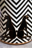 Close-up image of the panthers on the Pair Of Panthers Chevron Table Lamp With Black Shade