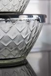 Close-up image if the largest bowl from the Set Of 5 Glass Bowls With Black Lids