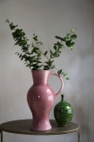 Lifestyle image of the Tall Pink Glazed Jug Style Vase With Handle