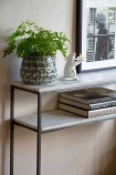 Close-up image of the Two-Tier Marble Shelf Console Table