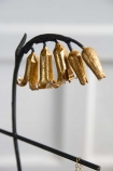 Close-up image of the flower detail on the Wooden Jewellery Stand With Golden Bluebell Flowers