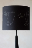 Image of the Linea Face Design Pendant & Lamp Shade - Black With Gold Interior on a lamp