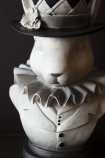 Close-up detail image of the head on the Alice In Wonderland 'Rabbit' Bust Plant Holder with dark wall background