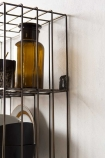 Close-up detail image of the rack on the Antique Brass Coloured Wire Wall Rack & Hooks fixture to wall