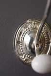 detail image of Antique Silver Crochet Coat Hook on grey wall background
