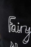 detail image of white stitching on Bella Freud Merino Wool Fairytale Of New York Cushion
