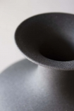 detail image of rim on Black Powder Coated Decanter Vase with grey wall background