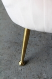 Close-up of the legs on the Blush Pleated Velvet Tub Armchair
