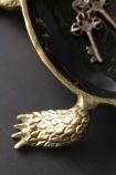 detail image of foot on Brass & Black Enamel Turtle Trinket Dish with keys inside on black table
