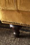 Detail image of legs & stud detail on the Ochre Gold Velvet Chesterfield Sofa