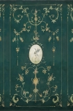 Close-up detail image of the Chinoiserie Panel Wallpaper Mural - Mirto Aloe gold tones renaissance style pattern on dark with bird in middle on green background