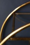detail image of Circular Art Deco 3-Tier Drinks Trolley with dark blue wall background