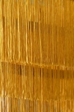 Close-up image of the tassels on the Gold Three-Tier Fringe Chandelier