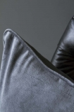 detail image of Glorious Velvet Cushion - Slate Grey on black chair with dark grey wall background