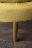 Close-up detail image of the legs on the Ochre Gold Velvet Petal Occasional Chair on wooden flooring