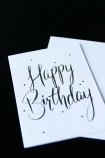detail image of Happy Birthday Greeting Card with envelope on black table
