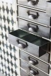 Close-up image of the Industrial-Style Filing Drawer Storage Cabinet with inside view of open drawer on a patterned wall background