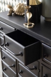 Close-up detail image of the Industrial-Style Black Metal Drawer Storage Cabinet inside drawer with gold ornaments on top of cabinet