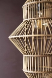 Close-up detail image of the Lantern Shape Bamboo Pendant Light on dark wall background