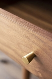 Close-up detail image of the drawer knob on the Mid-Century Design Two Drawer Desk