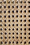 Close-up of the woven rattan detail on the Modern Woven Rattan Dining Chair