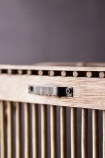 detail image of Hanging hook on the back of the Octagon Bamboo Two-Tier Shelf Unit with dark wall background