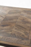 Close-up detail image of the tabletop on the Parquet Wood Dining Table