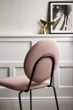Lifestyle image showing the back of the Modern Round Back Dining Chair In Blush Pink