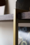 lose-up image of the brass frame on the Herringbone Style Dark Wood & Antique Brass 4-Shelf Unit