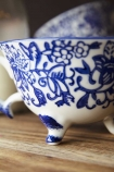 Close-up detail image of the pattern on the Pretty Indigo Blue & White Teacup on wooden shelf
