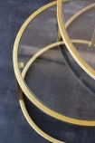 Close-up image of the Set Of 2 Circular Glass & Brass Coffee Tables