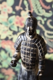 Close-up detail image of the Standing Qin Dynasty Figure Ornament with Rockett St George Oriental Garden Wallpaper in background