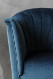 detail image of The Lovers Velvet Chair - Midnight Blue with grey wall background