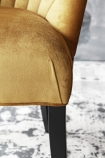 detail image of leg of The Lovers Velvet Chair - Golden Glow grey wall background