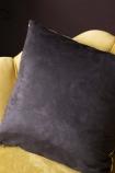 detail Image of the black back on the Sleeping Tiger Velvet Cushion on ochre gold velvet chair on dark wall background