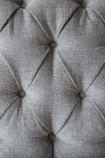 Close-up image of the button detailing on the Soft Grey Modern Chesterfield 3 Seater Sofa