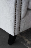 Close-up image of the stud detailing on the Soft Grey Modern Chesterfield 3 Seater Sofa