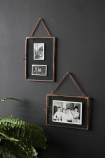 Set Of 2 Photo Frames With Chain - Copper with black and whiyte photographs inside on dark wall lifestyle image
