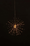 lifestyle image of Small Pretty Wire Starburst Light  - 2 Colours Available with black wall background
