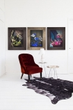 lifestyle image of Still Life Canvas Print - Yellow with other paintings and red chair on cowhide