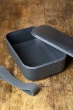 Image of the Dark Grey Lunchbox With Handy Silicone Band with the band and lid off