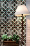 lifestyle image of Toro Wallpaper with white shade floor lamp and wooden side table with plants