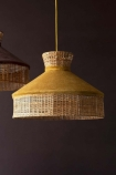 Lifestyle image of the Gold Mustard Velvet & Rattan Pendant Ceiling Light on a dark brown wall background