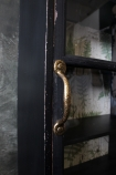 detail image of handle on Tall & Slim Distressed Black Wall Cabinet with Botanical Lining