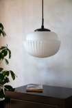 Lifestyle image of the White Glass Acorn Pendant Light