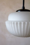 Close-up image of the White Glass Acorn Pendant Light