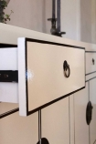 Close-up image of one of the drawers open on the Oriental Gloss White Sideboard