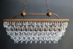 landscape detail image of Stunning Crystal Droplets Chandelier on grey wall background