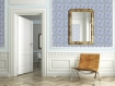 landscape lifestyle image of Louise Body Old Blue Tile Wallpaper - Panel with brown chair and wall mirror and white doorway